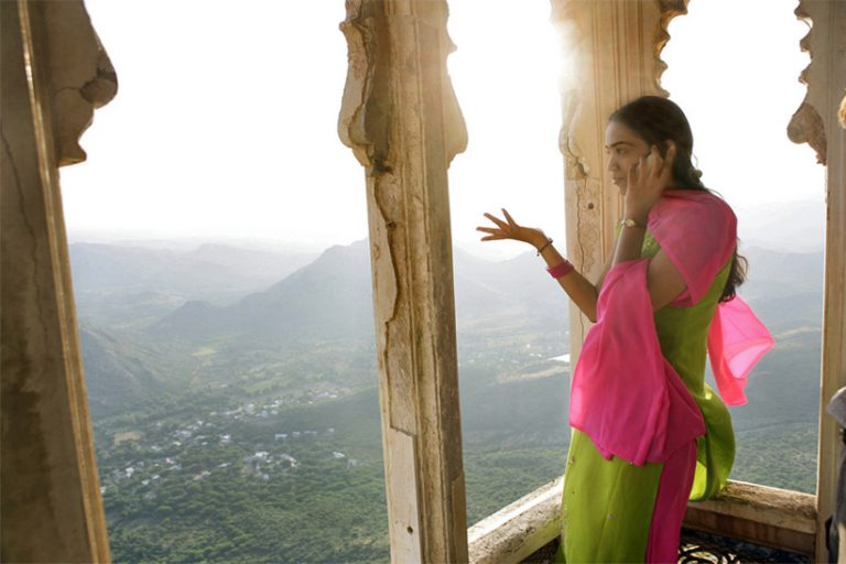 High in the hills above Udaipur, a vision takes a phone call. Composition for this shot was easy: just out of frame to the right is her friend - a bit of sleeve is just in view.